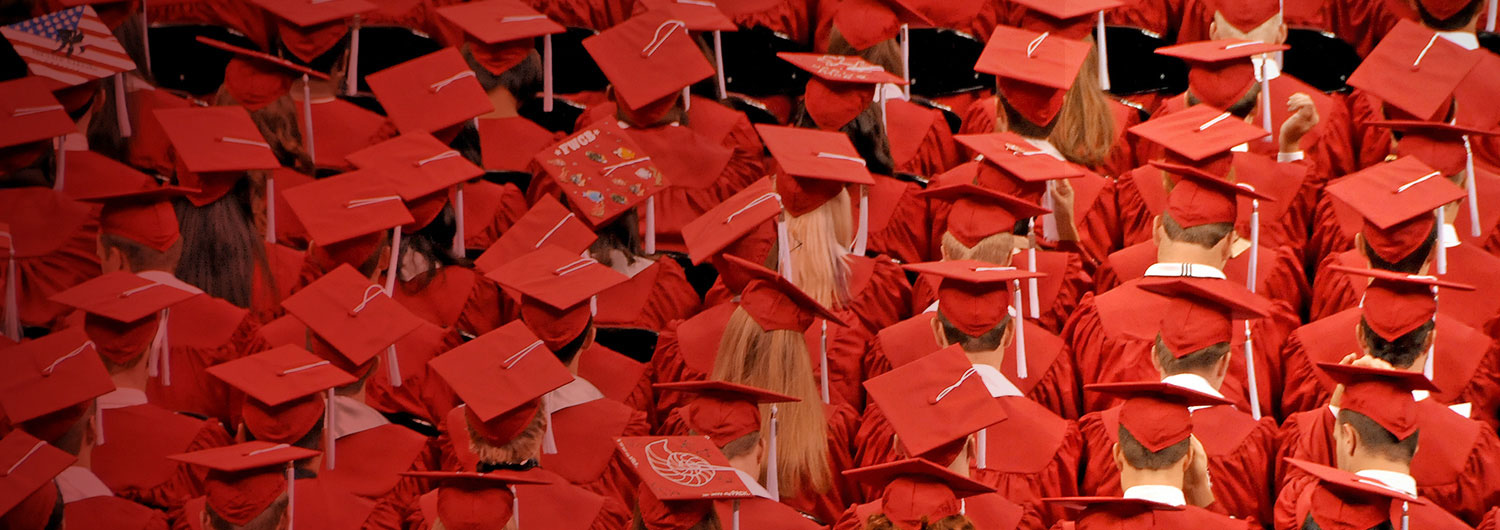 NC State graduates in caps and gowns