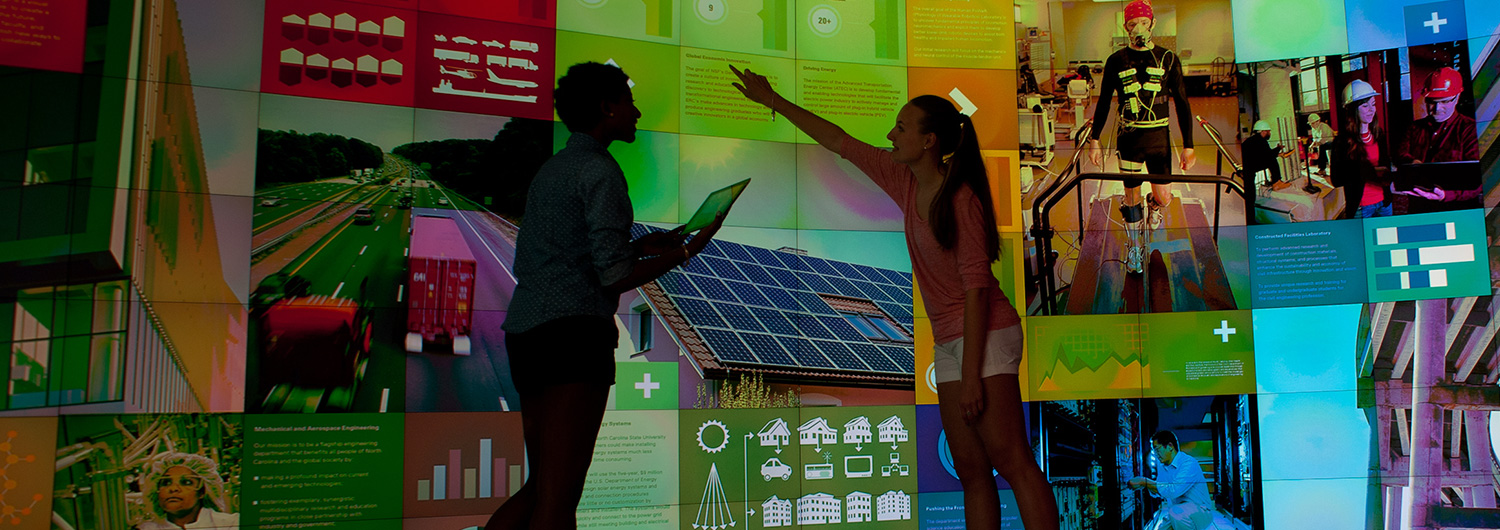 Students use the micro tile wall at the IPearl Immerstion theater at Hunt Library.