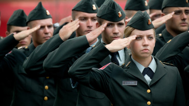 NC State military students in uniform saluting
