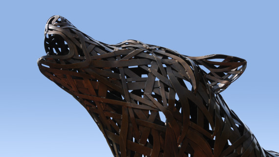 Metal sculpture of a wolf howling