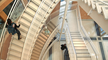 A student makes her way upstairs in the Engineering building on Centennial Campus.