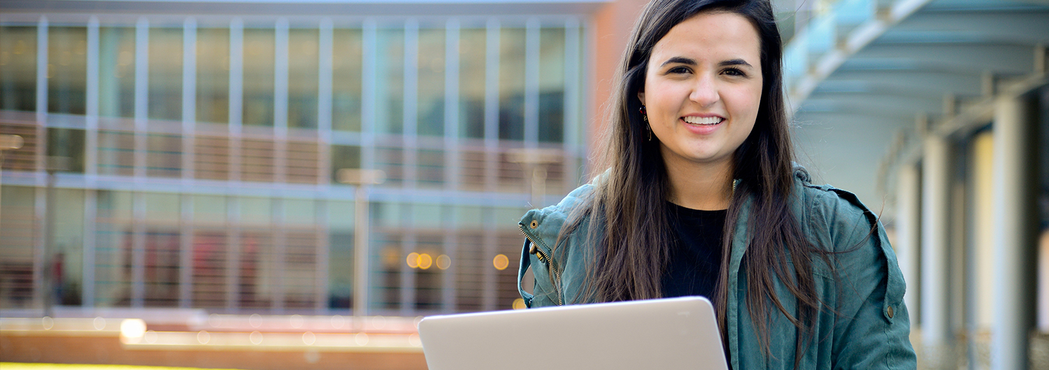 portrait of student with a laptop