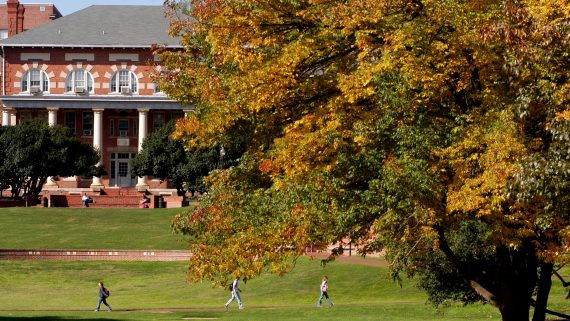 Students walk across Court of the Carolinas on a warm Fall morning.