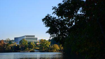 View of Centennial Campus from the south shore of Lake Raleigh.