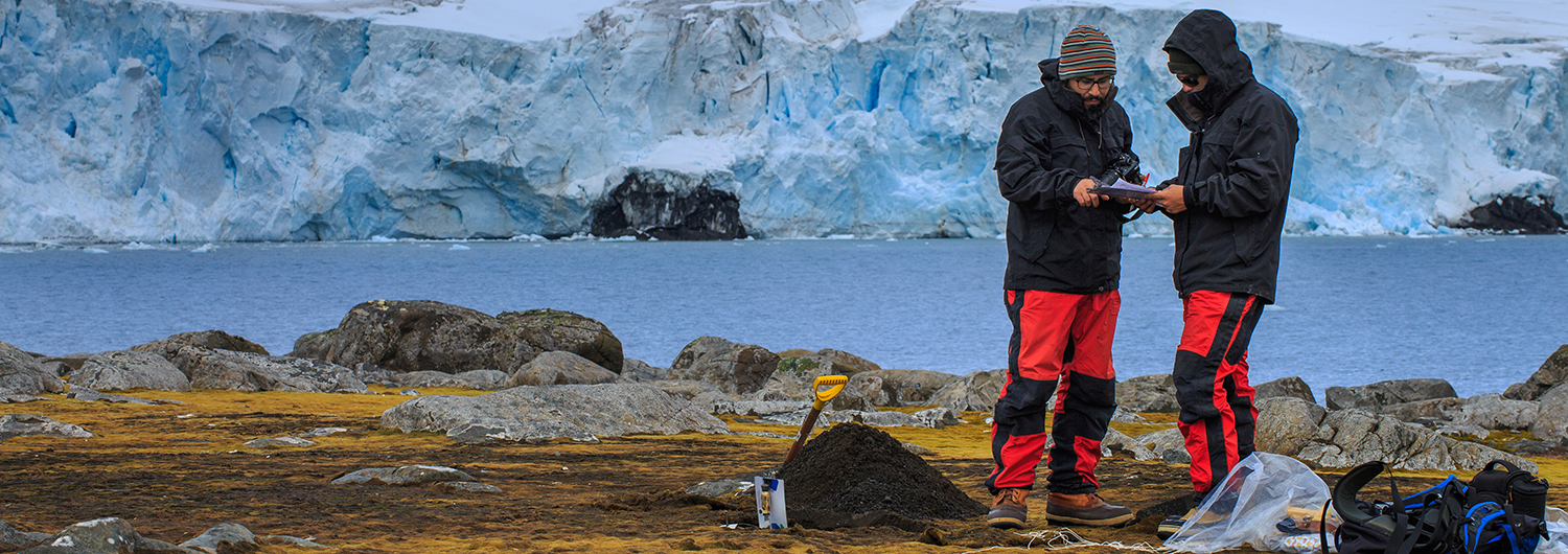 Two researchers studying in Nelson Island, South Shetland Islands, Antarctica