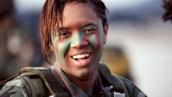 Student in army uniform smiles at camera