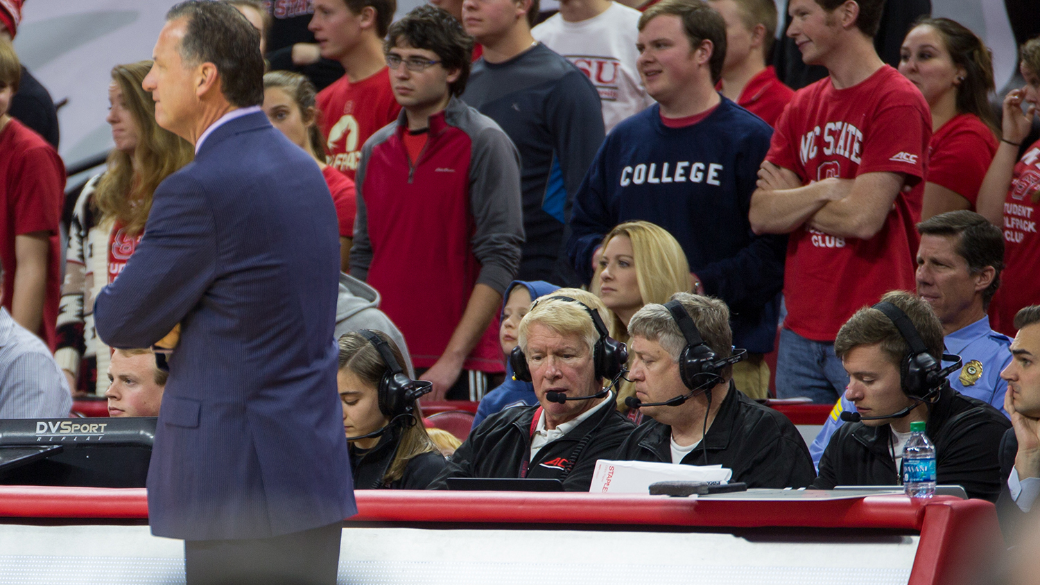 Online math instructor John Griggs coordinates game-day statistics for the NC State Men's Basketball team during a recent home game.