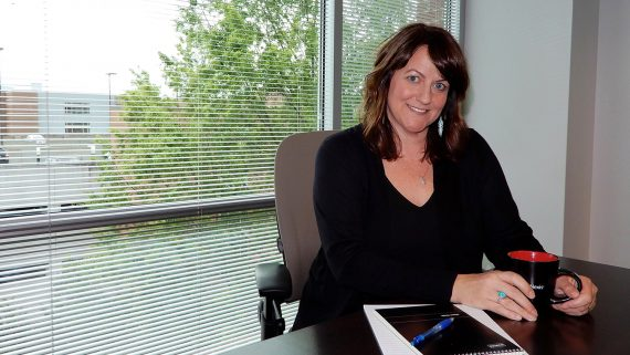 Professional woman sitting at a desk