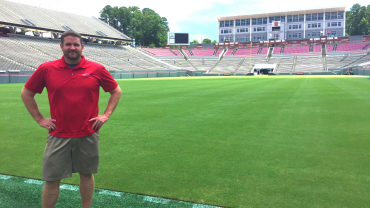Jonathan Stephens stands in the end zone at Carter-Finley Stadium.