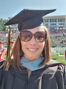 Sybil McCarrol in cap and gown at the Spring 2021 Commencement Ceremony at Carter-Finley Stadium