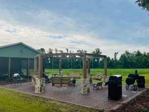 Firepit circle with hanging benches.