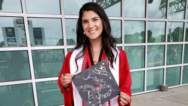 Claire Mangum pictured in NC State regalia outside of PNC Arena.